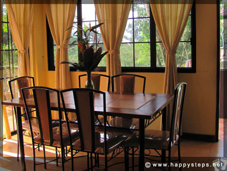 Mambukal Resort: Family Cottage - Dining area with glass doors offering a nice view of the outdoors
